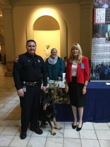 Atom, Bomb detection canine, and his handler visiting with Jody Allgood, GCC Secretary, and Gail LaBerge, GCC President at Sportsmans Day at the Georgia State Capitol on Thursday, January 14, 2016.